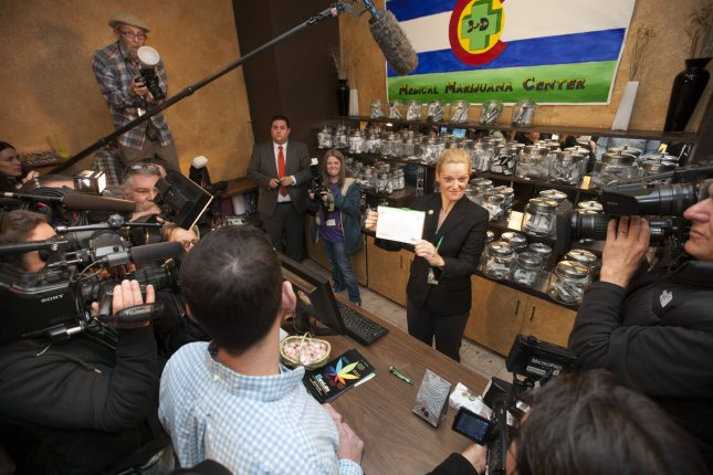 Store owner Toni Fox talks about the first purchase of recreational marijuana in Denver in 2014. A new study has found that opioid-related deaths have decreased in Colorado since it legalized recreational cannabis. File Photo by Gary C. Caskey/UPI