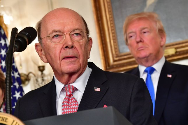 Commerce Secretary Wilbur Ross (L) speaks alongside President Donald Trump before the president signed an executive memorandum targeting China on trade. Trump's memorandum is aimed at cracking down what he calls unfair trade practices on Chinese economic practices and setting up the possibility of tariffs and restrictions on investment. Photo by Kevin Dietsch/UPI