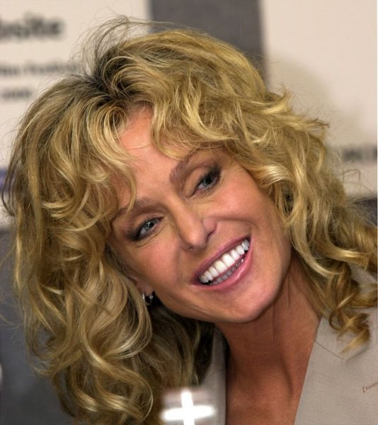 Farrah Fawcett, seen in a September 12, 2000 file photo at the Toronto International Film Festival, died in Los Angeles battling cancer on June 25, 2009. She was 62 years old. (UPI Photo/Christine Chew/File)
