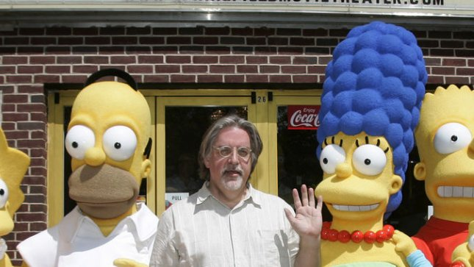 Simpsons creator Matt Groening (C) poses with Homer and Marge Simpson. (FILE/UPI Photo/Matthew Healey)