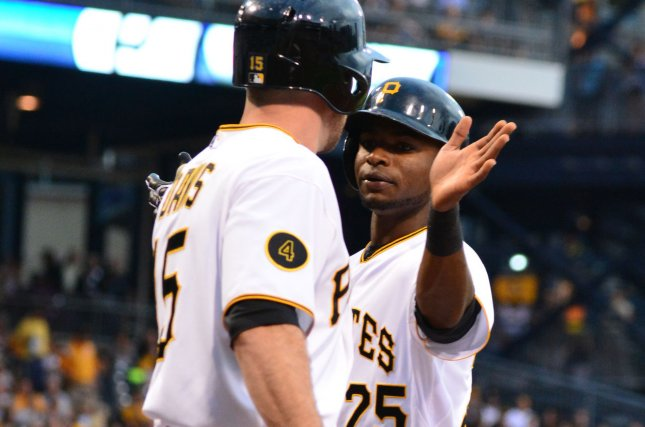 Pittsburgh Pirates first baseman Ike Davis (15) congradulates Pittsburgh Pirates right fielder Gregory Polanco (25) at home after Los Angeles Dodgers pitchers Dan Haren walks him home in first inning at PNC Park in Pittsburgh, on July 23, 2014. UPI/Archie Carpenter