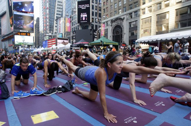 Thousands of participants gather in Times Square to Practice Yoga in New York City. (File/UPI/John Angelillo)