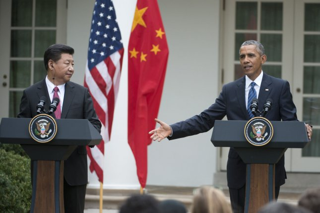 U.S. President Barack Obama and Chinese President Xi Jinping hold a joint press conference in the Rose Garden of the White House on Friday. Xi and Obama agreed not to conduct or support cybercrime hacking. Photo by Pat Benic/UPI