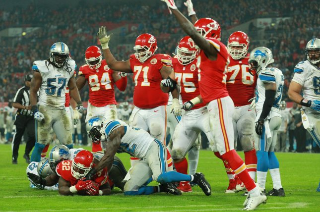 Kansas City Chiefs running back Spencer Ware scores a touchdownagainst the Detroit Lions during an International NFL series match at Wembley London on November 1, 2015. The Chiefs beat the Lions 45-10. Photo by Sean Dempsey/UPI