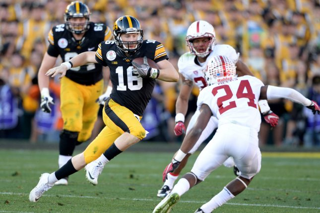 Iowa Hawkeyes' quarterback C.J. Beathard runs for yardage against Stanford in the Rose Bowl. Beathard signed a four-year deal with the 49ers on Tuesday. File photo by Jon SooHoo/UPI