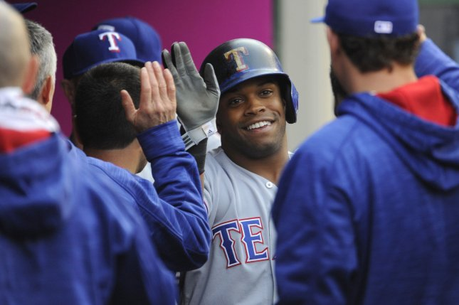 Texas Rangers outfielder Delino DeShields is congratulated by his teammates after hitting a home run in the fifth inning on April 9, 2016 at Angel Stadium in Anaheim, California. File photo by Lori Shepler/UPI