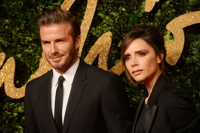 Victoria Beckham (R), pictured with David Beckham, appears on two new covers of British Vogue with her family. File Photo by Rune Hellestad/UPI