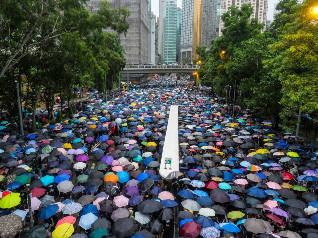 A massive crowd of protesters under umbrellas leave an anti-government rally in Hong Kong's Victoria Park on August 18, 2019. Organizers estimated 1.7 million people turned out for the demonstration. Photo by Thomas Maresca/UPI