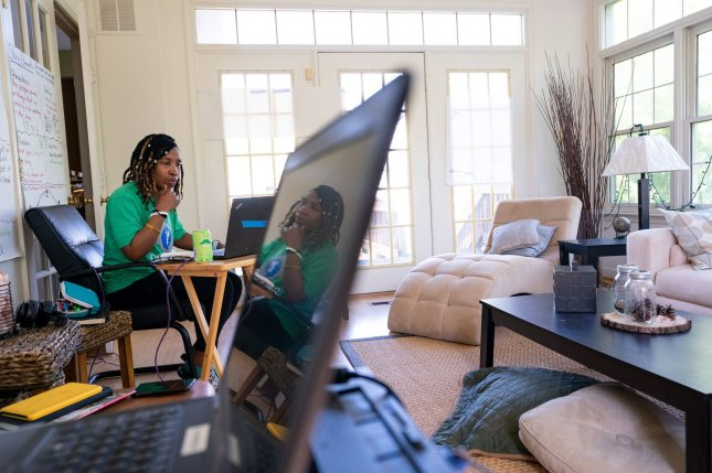 Second-grade teacher Imani Baucom instructs students remotely from her home in Bowie, Md., on May 4. File Photo by Kevin Dietsch/UPI