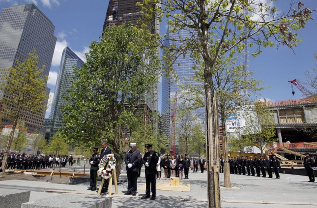 United States President Barack Obama bows his head with members of the NYPD and the FDNY after placing a wreath at Ground Zero, the site of the former Twin Towers, days after Osama Bin Laden was killed by U.S. Navy Seals almost 10 years after the terrorist attacks on the World Trade Center in New York on May 5, 2011. UPI/John Angelillo