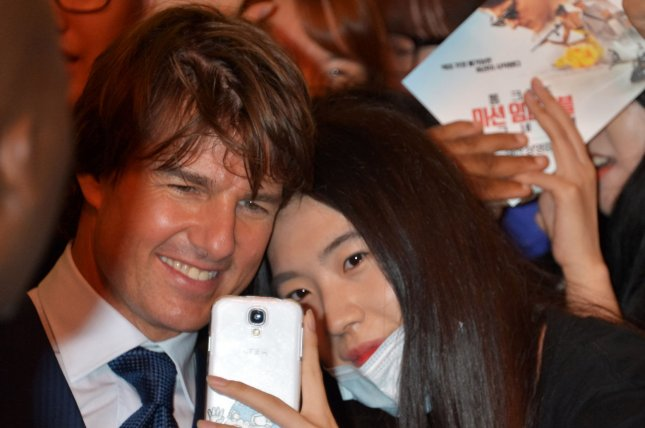 Actor Tom Cruise is greeted by eager fans as he attends the premiere of film Mission: Impossible - Rogue Nation in Seoul, South Korea, on Thursday. The 53-year-old actor has received a warm welcome in South Korea. Photo by Keizo Mori/UPI