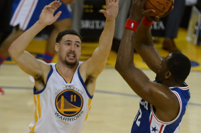 Golden State Warriors' Klay Thompson (11) harasses Philadelphia 76ers' Elton Brand in the second half at Oracle Arena in Oakland, California on March 27, 2016. Thompson scored 40 points in the Warriors 117-105 win. Photo by Terry Schmitt/UPI