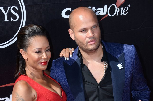 Mel B, real name Melanie Brown and her estranged husband Stephen Belafonte on July 15, 2015. Brown's former nanny is now suing the singer for libel after Brown obtained an restraining order against Stephen Belafonte. File Photo by Jim Ruymen/UPI