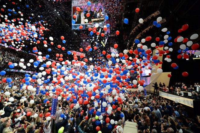 Balloons and confetti fall on then-GOP presidential candidate Donald Trump and running mate Mike Pence on the final day of the Republican National Convention in Cleveland, Ohio, on July 21, 2016. File Photo by Pat Benic/UPI