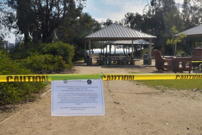 A sign informs the public of the closure at Elysian Park in Los Angeles, Calif., which was shuttered until further notice on March 28 due to the coronavirus pandemic. Photo by Jim Ruymen/UPI