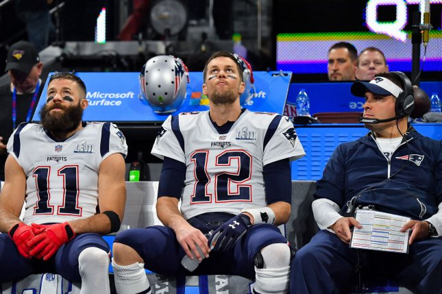 Former Patriots quarterback Tom Brady (12) and offensive coordinator Josh McDaniels (R) worked together for almost two decades in New England. File Photo by Kevin Dietsch/UPI