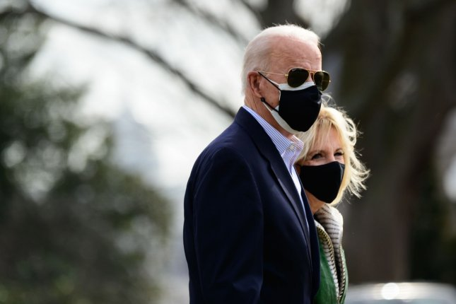 President Joe Biden (L) and first lady Jill Biden walk on the South Lawn of the White House on Friday before boarding Marine One in Washington, D.C. Photo by Erin Scott/UPI