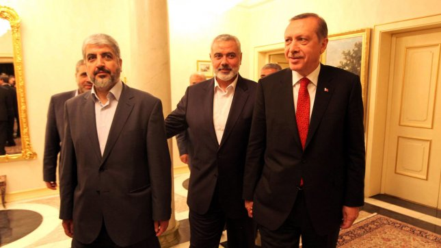 Turkish Prime Minister Recep Tayyip Erdogan (R) meets Khalid Mashaal (L), the Hamas chief in exile, and Gaza's prime minister Ismail Haniyeh(C) in Ankara, Turkey on June 18, 2013. UPI/Palestinian PM Media