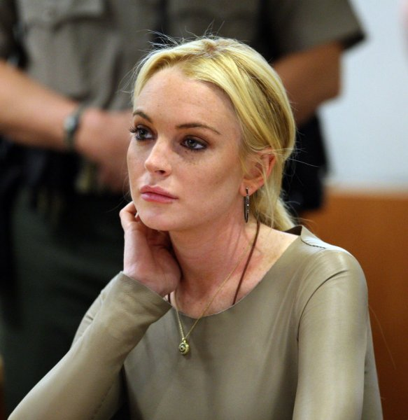 Actress Lindsay Lohan appears in a courtroom during a hearing in Los Angeles on March 10, 2011. Lohan rejected a plea agreement offered by prosecutors in a grand theft case that included a guaranteed return to jail. She told a Superior Court judge she agreed to delaying her case until a preliminary hearing when prosecutors will present evidence against her. Lohan is accused of taking a $2,500 necklace from a Venice jewelry store. UPI/David McKnew/Pool