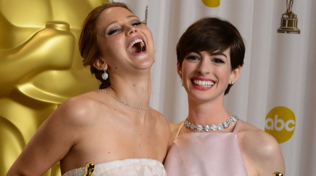 Actress Jennifer Lawrence and actress Anne Hathaway hold their Oscars backstage at the 85th Academy Awards at the Hollywood and Highland Center in the Hollywood section of Los Angeles on February 24, 2013. (File/UPI/Jim Ruymen)