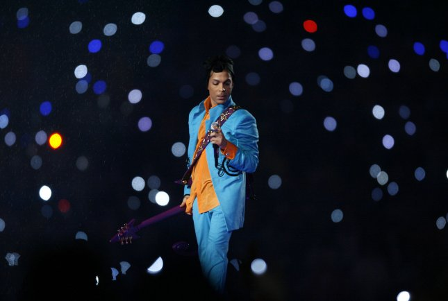 Prince performs during halftime at Super Bowl XLI at Dolphin Stadium in Miami in 2007. The performer died Thursday at age 57 at his estate in Minnesota. File Photo by Gary C. Caskey/UPI