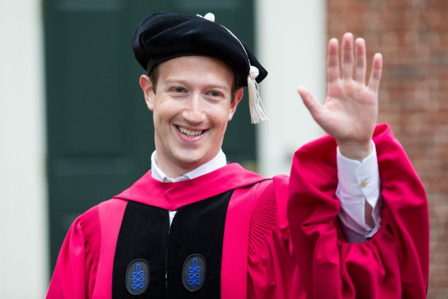Facebook CEO Mark Zuckerberg waves to the crowd at the 366th Commencement for Harvard University at Tercentenary Theatre in Cambridge, Mass., on May 25. On Thursday he announced Facebook would be handing over information about ads the company sold to Russia-linked fake accounts during the 2016 election. File Photo by Matthew Healey/ UPI