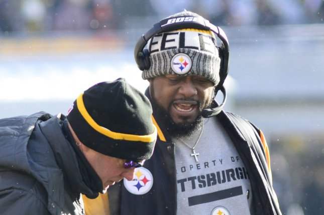 Pittsburgh Steelers head coach Mike Tomlin checks on the condition of Pittsburgh Steelers offensive guard B.J. Finney during the first half of the Steelers' 28-24 win at Heinz Field in Pittsburgh on December 31, 2017. Photo by Archie Carpenter/UPI