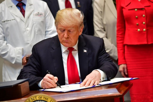 President Donald Trump signs the Know the Lowest Price Act and Patients Right to Know Drug Prices Act during a ceremony at the White House in Washington, D.C. on Oct. 10. Photo by Kevin Dietsch/UPI