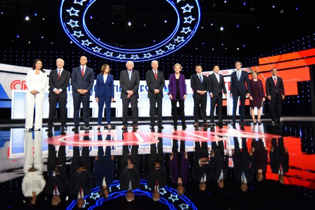 Democratic presidential candidates take the stage prior to the CNN/New York Times Democratic debate Tuesday. Photo by Robert Moorhead/UPI
