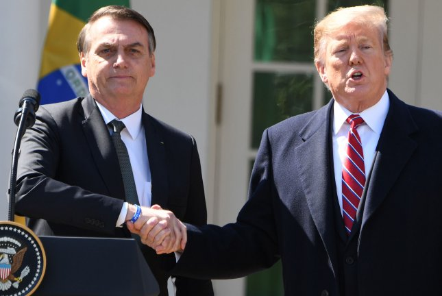 President Donald Trump shakes hands with Brazilian President Jair Bolsonaro in the Rose Garden of the White House on March 19, 2019. File Photo by Pat Benic/UPI