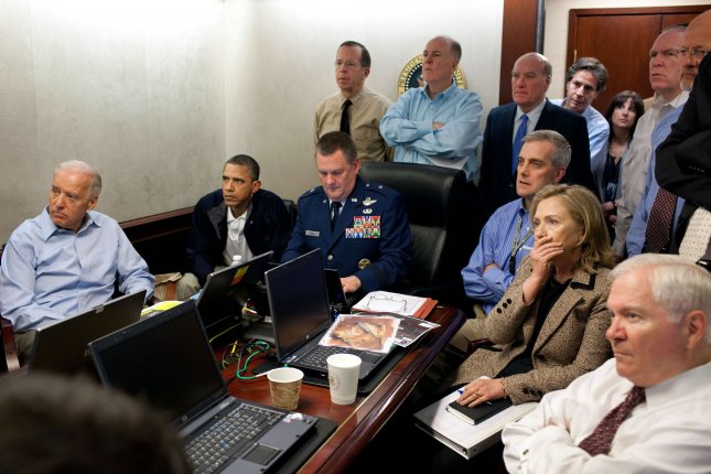 U.S. President Barack Obama and Vice President Joe Biden, along with with members of the national security team, receive an update on the mission against Osama bin Laden in the Situation Room of the White House, May 1, 2011. Please note: a classified document seen in this photograph has been obscured. UPI/Pete Souza/White House