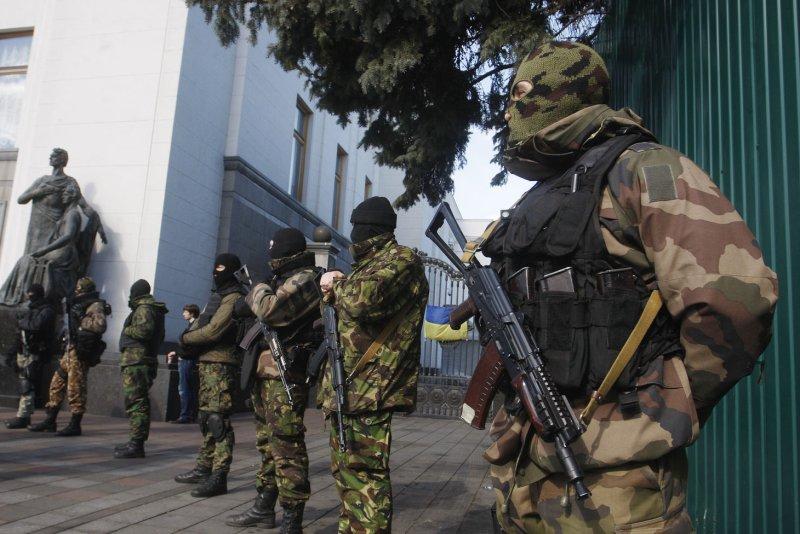 Ukrainian self defense volunteers stand outside the parliament building in Kiev on March 17, 2014 a after the referendum on independence in Crimea. (UPI/Ivan Vakolenko)