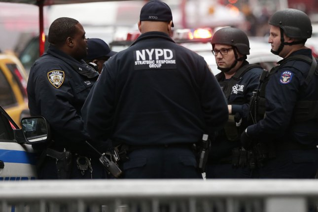 NYPD officers stand in Times Square Tuesday, a day after after a bomb exploded in the Port Authority Bus Terminal in midtown Manhattan. Suspect Akayed Ullah is expected to be arraigned Wednesday. Photo by John Angelillo/UPI