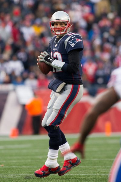 New Englad Patriots quarterback Tom Brady drops back to pass in a game against the Buffalo Bills on Dec. 24. Photo by Matthew Healey/UPI