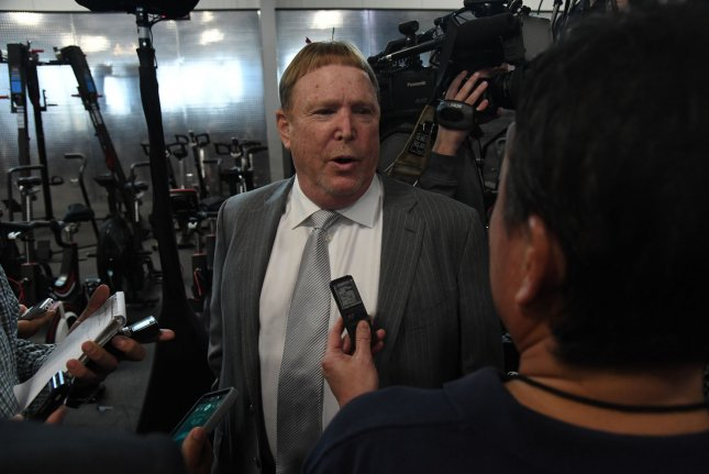 Oakland Raiders owner Mark Davis (L) answers questions on January 9, 2018 at the Raiders Headquarters in Alameda, California. Photo by Terry Schmitt/UPI