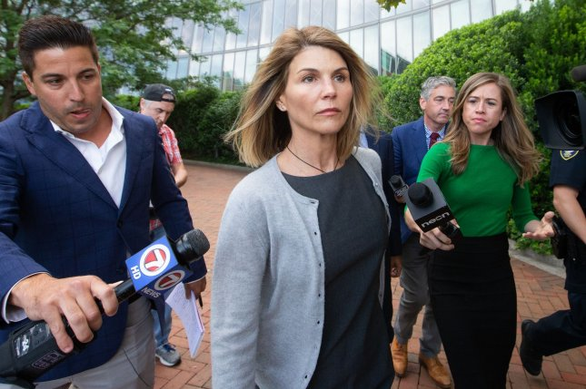 Actress Lori Loughlin exits the John Joseph Moakley U.S. Courthouse in Boston following a hearing related to the college cheating scandal on August 27. File Photo by Matthew Healey/UPI