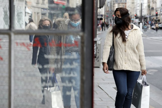 Pedestrians wear face masks to guard against COVID-19 as they walk on a street in Paris, France, on May 12. Photo by Eco Clement/UPI