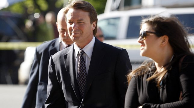Former U.S. Senator and presidential candidate John Edwards arrives with his daughter Cate at the federal courthouse in Greensboro, North Carolina on April 24, 2012. The former presidential candidate is accused of violating federal campaign finance laws. UPI/Nell Redmond