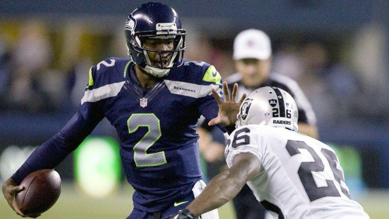Seattle Seahawks' quarterback Josh Portis (L) File/UPI/Jim Bryant