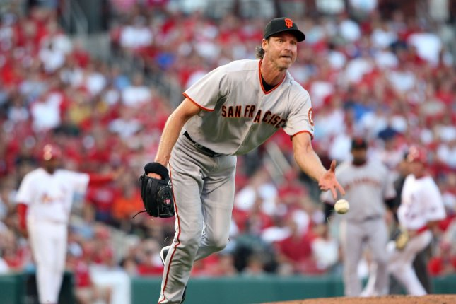 San Francisco Giants starting pitcher Randy Johnson flips the baseball to first base to put out St. Louis Cardinals Yadier Molina in the second inning at Busch Stadium in St. Louis on June 30, 2009. (UPI Photo/Bill Greenblatt)