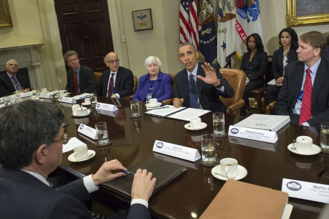 President Barack Obama meets with financial regulators and advisers in the Roosevelt Room of the White House in Washington, D.C., on Monday. During the meeting, Obama defended his administration's efforts to recover from the 2007-09 financial crisis and said regulations and Wall Street reforms are working. Photo by Pat Benic/UPI