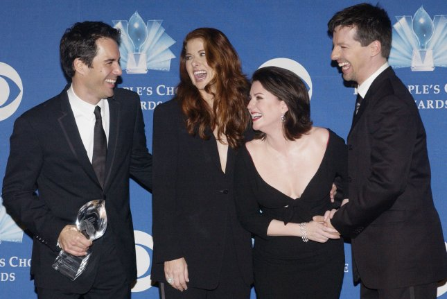 Eric McCormack (L), holds the award for favorite television comedy series for Will & Grace, as he poses with cast members Debra Messing, Megan Mullally and Sean Hayes (L-R) backstage at the 31st Annual People's Choice Awards on anuary 9, 2005. The cast has reunited to film a new scene for the series that focuses on the currently ongoing presidential election. File Photo by Raphael Lanus/UPI