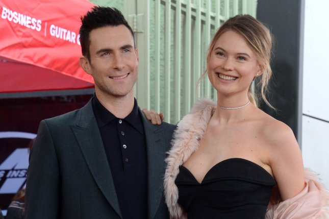 Adam Levine (L) with his wife Behati Prinsloo. The singer is developing a new series for YouTube titled Sugar. File Photo by Jim Ruymen/UPI