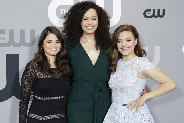Left to right, Melonie Diaz, Madeleine Mantock and Sarah Jeffery of Charmed arrive at The CW Network's 2018 upfront on May 17 in New York City. The show is to debut Sunday. File Photo by John Angelillo/UPI