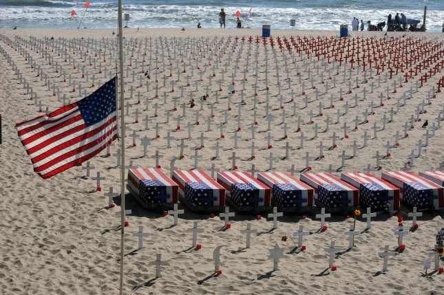 Thousands of war memorial crosses are shown on display at the Arlington West Memorial Project in Santa Monica, California on May 29, 2011. The beach memorial represents thousands of soldiers killed in Iraq Afghanistan. The 12 mock caskets represent the soldiers killed that week. File Photo by Jim Ruymen/UPI