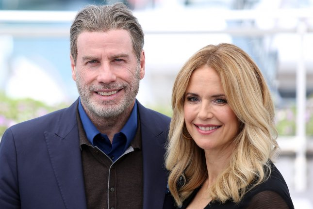 Kelly Preston (R) and John Travolta arrive at a photocall for the film Gotti during the 71st annual Cannes International Film Festival on May 2018. Stars, including Russell Crowe and Maria Shriver, paid homage to Preston on social media following her death. File Photo by David Silpa/UPI
