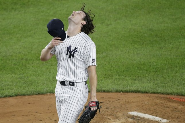 New York Yankees starting pitcher Gerrit Cole flips his hair back before refitting his cap in the fourth inning of a game Wednesday against the Tampa Bay Rays, at Yankee Stadium in New York City. Photo by John Angelillo/UPI