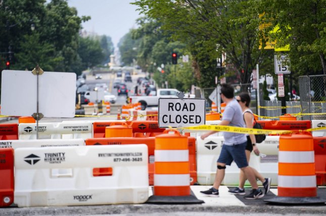 Orange traffic cones and barriers line the streets of Black Lives Matter Plaza near the White House in Washington, D.C., on Thursday. A group of bipartisan Senators on Sunday finalized a $1 trillion infrastructure bill to, among other things, rebuild the country's roads. Photo by Sarah Silbiger/UPI