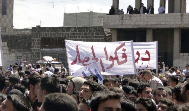 Syrian anti-government protesters hold a protest calling for the end of calling for an end to the regime of President Bashar al-Assad in Nawa, Darra city, Syria, on May 6, 2011. UPI