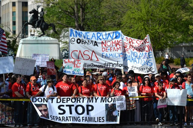 Demonstrators gather at the White House for a immigration protest in Washington, D.C. on May 1, 2014. UPI/Kevin Dietsch